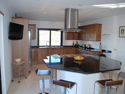 Spacious kitchen with central cooking island